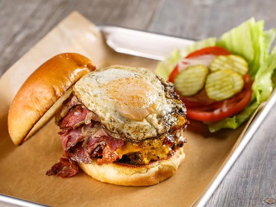 Jimmy P's Hangover Burger features double Wagyu beef patties, pastrami, a fried egg, bacon and cheddar.
