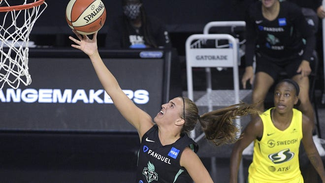 New York's Sabrina Ionescu beats Seattle' Jewell Loyd, right, to the basket during the second half of Saturday's WNBA game in Bradenton, Fla.