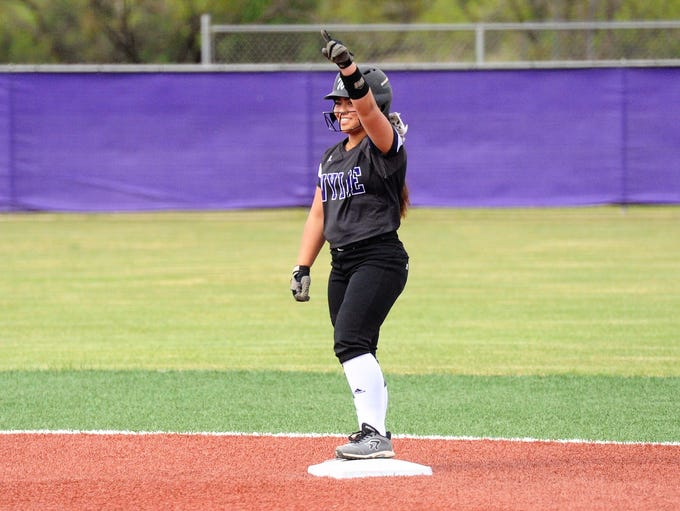 Wylie second baseman Halle Arbilera (8) points to the