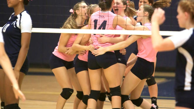 Asheville Christian Academy volleyball players celebrate after a point Tuesday in Swannanoa.