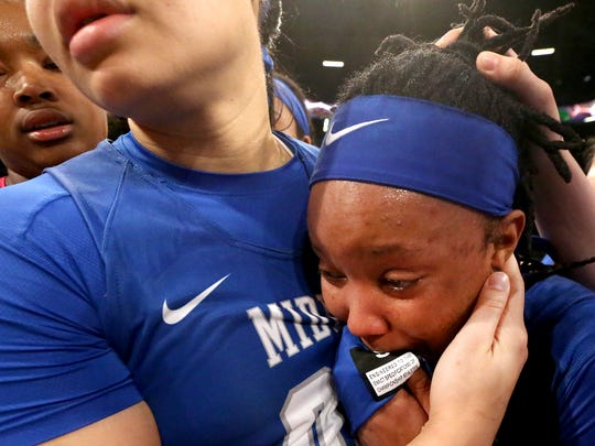 MTSU's Alex Johnson (00), left, comforts MTSU senior Ty Petty (20) following the lose to Georgia Tech in the 3rd round of the WNIT Tournament on Thursday, March 23, 2017, in Atlanta.