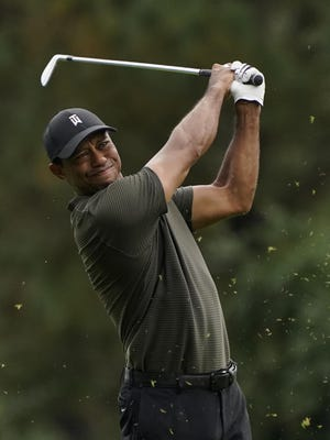 Tiger Woods hits on the 15th fairway Thursday in Augusta, Ga.