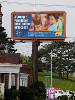 Cincinnati Public Schools billboard at North Bend and Colerain Tuesday April 19, 2016. Many public school districts have starting to advertise to enroll students.