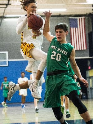 Naples High School's Terrence Dejohn goes up over Fort Myers High's Jake Cox during a Class 7A regional quarterfinal game in Naples, Fla., on Thursday, Feb. 16, 2017.