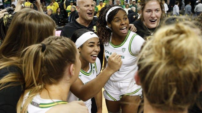 Oregon's Kelly Graves, Minyon Moore, Ruthy Hebard and Sedona Prince celebrate the  No. 6 Ducks' win over No. 3 Stanford, 87-55, at Matthew Knight Arena. [Andy Nelson/The Register-Guard] - registerguard.com