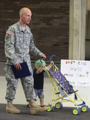 The 645th Regional Support Group will be deployed overseas staff sargent Thomas Bolden and his son Benjamin Bolden 1yr, after a ceremony held at the Southfield Pavilion Saturday, July 23, 2016 in Southfield MI. Kirthmon F. Dozier/Detroit Free Press