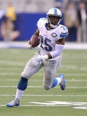 Lions running back Theo Riddick runs for a first down against the Indianapolis Colts on Sunday.