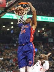 Pistons forward Tobias Harris (34) dunks the ball against