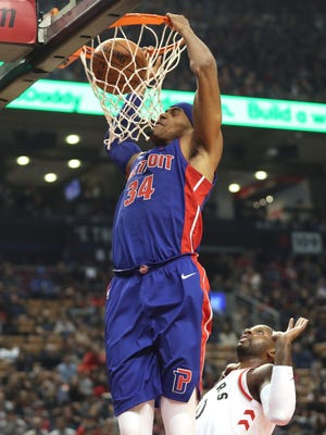 Pistons forward Tobias Harris (34) dunks the ball against the Raptors during the Pistons' 116-94 exhibition loss on Tuesday, Oct. 10, 2017, in Toronto.