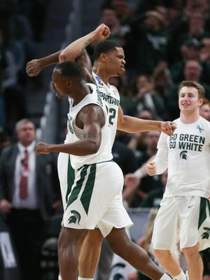 Michigan State's Miles Bridges and Joshua Langford celebrate after a basket against Bucknell during the first half of the NCAA tournament Friday, March 16, 2018 at Little Caesars Arena.