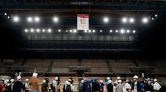 "Members of the media gather near a ""1-Year to Go"" banner during a tour Monday, July 22, 2019, in Tokyo. Despite scandals, rising costs and doubts about the economic payoff, the Tokyo Olympics will be a must-see event — if you can find a ticket or a hotel room — when they open in a year. Tokyo was supposed to be a ""safe pair of hands"" after Rio de Janeiro's corruption and near-meltdown three years ago. (AP Photo/Jae C. Hong)"