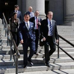 Benjamin Wey, CEO of New York Global Group, bottom left, leaves Manhattan Federal Court Wednesday on June 24.
