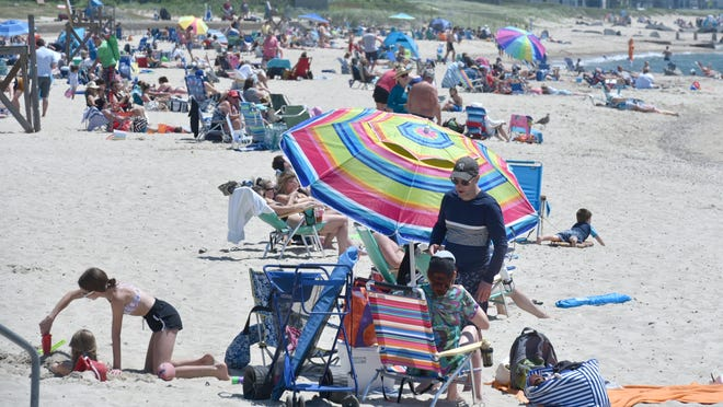 A hot first day of summer brought the crowds to Falmouth Heights Beach on Saturday to enjoy the sand, sun and surf.