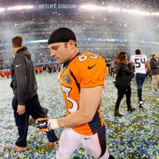 EAST RUTHERFORD, NJ - FEBRUARY 02:  Wide receiver Wes Welker #83 of the Denver Broncos walks off the field after their 43-8 loss to the Seattle Seahawks during Super Bowl XLVIII at MetLife Stadium on February 2, 2014 in East Rutherford, New Jersey.  (Photo by Kevin C. Cox/Getty Images)