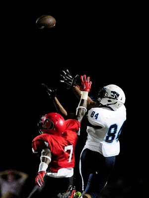Centennial wide receiver Emanuel Hall tries to catch a pass against Overton defensive back Ugo Amadi during Friday's game.