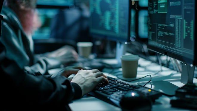 Stock image of hacker using keyboard.