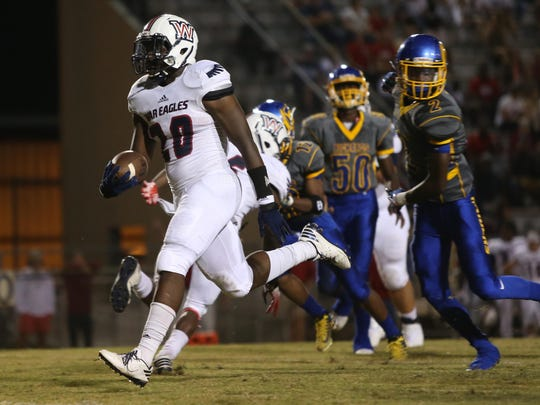 Wakulla's Brandon Berry strides into the endzone for a touchdown during their game against Rickards at Cox Stadium on Thursday night.