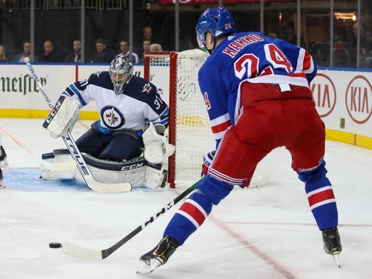 Winnipeg Jets goaltender Connor Hellebuyck (37) watches a shot by New York Rangers right wing Kaapo Kakko (24) before making the save during the second period of an NHL hockey game Thursday, Oct. 3, 2019, at Madison Square Garden in New York. (AP Photo/Mary Altaffer)