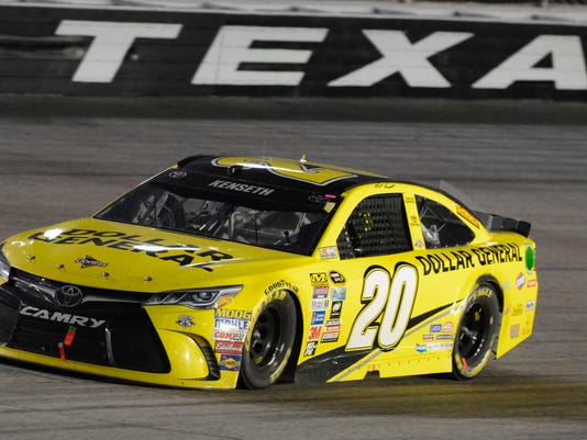 Matt Kenseth drives during the NASCAR Sprint Cup Series auto race at Texas Motor Speedway in Fort Worth, Texas, Saturday, April 9, 2016. (AP Photo/Larry Papke)