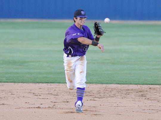Wylie shortstop Gatlin Martin (21) throws to first for an out during the Bulldogs' playoff game Thursday against Graham.