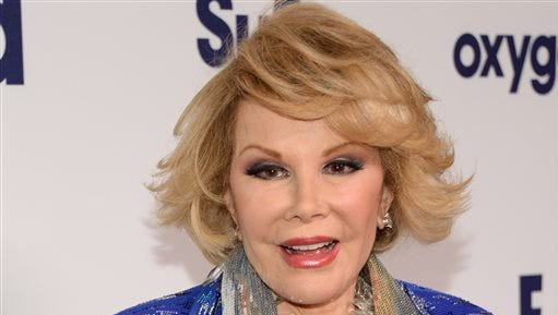 In this May 15, 2014 file photo, Joan Rivers attends the NBCUniversal Cable Entertainment 2014 Upfront at the Javits Center in New York. For comedians, there was very little to laugh about in 2014. Three pioneering comic legends died - David Brenner, Rivers and Robin Williams.