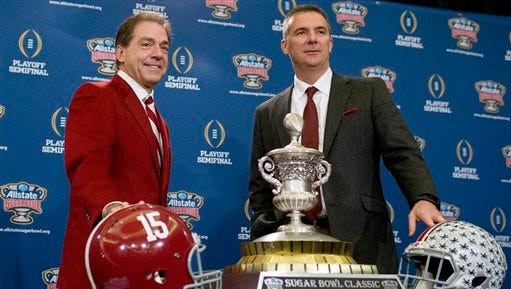 Alabama coach Nick Saban, left, and Ohio State coach Urban Meyer pose with the Sugar Bowl Classic trophy during a press conference at the Marriott downtown convention center in New Orleans, Wednesday, Dec. 31, 2014. Alabama is slated to square off against Ohio State in the Sugar Bowl NCAA college football playoff semifinal on New Year's Day.