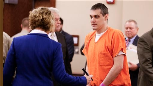 Zachary Adams, center, talks with his attorney after a hearing Dec. 17 in Decaturville. Adams is charged with the 2011 kidnap and murder of nursing student Holly Bobo.