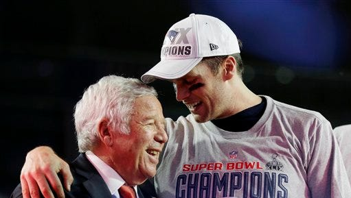 New England Patriots quarterback Tom Brady, right, celebrates with owner Robert Kraft after the NFL Super Bowl XLIX football game against the Seattle Seahawks Sunday, Feb. 1, 2015, in Glendale, Ariz. The Patriots won 28-24.