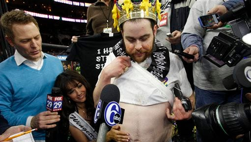 Patrick Bertoletti, poses for the media after winning the Wing Bowl eating contest, Friday, Jan. 30, 2015 in Philadelphia. Bertoletti won with a Wing Bowl record 444 wings in 26 minutes. He edged out 2014 champion Molly Schuyler, of Bellevue, Nebraska, who eclipsed her record 363-wing mark with 440 wings.  Wing Bowl started in 1993 as a way for Philadelphia's long-suffering sports fans to blow off steam before the Super Bowl. About 20,000 people gathered at the Wells Fargo Arena.