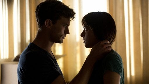 "Jamie Dornan, left, and Dakota Johnson star in ""Fifty Shades of Grey."""