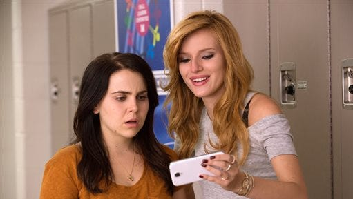 "In this image released by CBS Films, Mae Whitman, left, and Bella Thorne appear in a scene from ""The DUFF."" (AP Photo/CBS Films, Guy D Alema)"