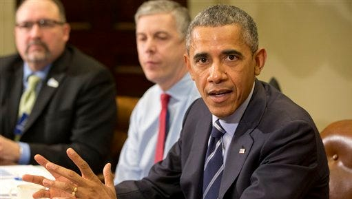 President Barack Obama speaks at the White House on Monday March 16, 2015, during a meeting with leaders of urban school districts.  Education Secretary Arne Duncan sits next to him. The president is  calling for a focus on low-performing schools, annual assessments and investments in special education and English-language learners.