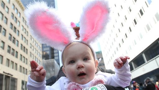 Maelie Swanson held by her father Jeff Swanson participate in the Easter Parade along New York's Fifth Avenue on Sunday, April 5, 2015.