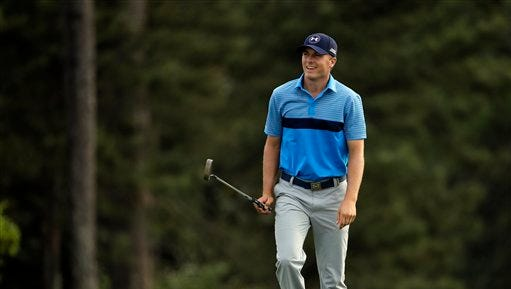 Jordan Spieth walks up to the 18th green during the first round of the Masters golf tournament Thursday in Augusta, Georgia.