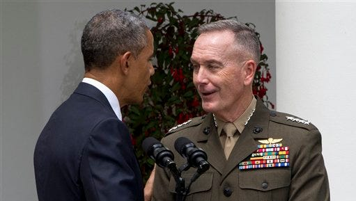 President Barack Obama shakes hands with Marine Gen. Joseph Dunford Jr., after announcing Dunford's nomination as the next chairman of the Joint Chiefs of Staff, Tuesday, May 5, 2015, in the Rose Garden of the White House in Washington. Obama chose the widely respected, combat-hardened commander who led the Afghanistan war coalition during a key transitional period during 2013-2014 to succeed Army Gen. Martin Dempsey. (AP Photo/Jacquelyn Martin)