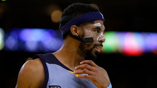 Memphis Grizzlies' Mike Conley celebrates a score against the Golden State Warriors during the fourth quarter in Game 2 in a second-round NBA basketball playoff series Tuesday, May 5, 2015, in Oakland, Calif. (AP Photo/Ben Margot)