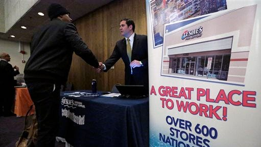 A sign at a recruiting station for Leslie's Pool supplies on April 22, 2015, boasts that it is a great place to work during a National Career Fairs job fair, in Chicago.