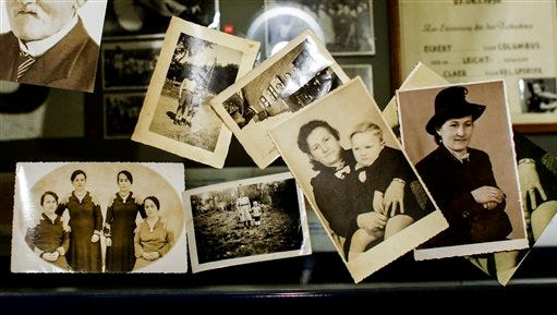 The March 18, 2015 photo shows several undated family photos provided by Paul Schmitz, a son of a United States WWII soldier, showing him as a little boy with his mother, center right picture. Paul Schmitz talked to The Associated Press about his father and his life in post WWII Germany during an interview at the Allied Museum in Berlin. (AP Photo)