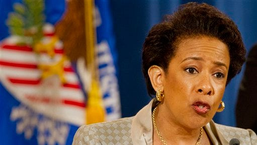 Attorney General Loretta Lynch announces a civil rights investigation of the Baltimore Police Department during a news conference at the Justice Department in Washington,  Friday, May 8, 2015. Lynch  announced the Justice Department will conduct a broad investigation into the Baltimore police force in search of law enforcement practices that are unconstitutional and violate civil rights.  (AP Photo/Jacquelyn Martin)