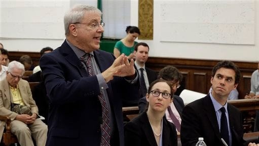 """Steven Wise, president of the Nonhuman Rights Project, left, present his arguments in Manhattan State Supreme Court, in New York, Wednesday, May 27, 2015. Lawyers for two chimpanzees went to court to argue that the animals have """"personhood"""" rights and should be freed from the Long Island university where they are kept. Listening are Natalie Prosin, executive director of the Nonhuman Rights Project, and Assistant Attorney General Christopher Coulston, right.  (AP Photo/Richard Drew, Pool)"""
