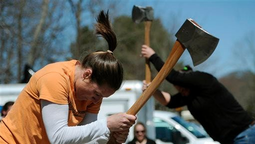 In this April 25 photo, Alissa Harper, left, and Michele Watkins chop blocks of wood during the Axe Women of Maine's demonstration in Vernon, Conn.