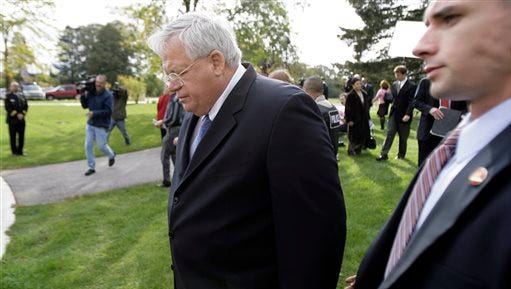 FILE - In this Oct. 10, 2006 file photo, then House Speaker Dennis Hastert, left, walks away from the media after answering questions about ex-Rep. Mark Foley's involvement with former pages at a news conference in Aurora, Ill. The 73-year-old Hastert appears in court Tuesday, June 9, 2015 for the first time since an indictment two weeks ago alleged the former U.S. House speaker agreed to pay $3.5 million to someone from his days as high school teacher not to reveal a secret about past misconduct by the Illinois Republican.  (AP Photo/M. Spencer Green, File)