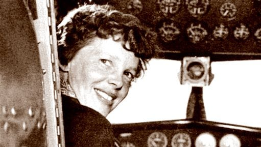 In this May 20, 1937 photo, provided by The Paragon Agency, shows aviator Amelia Earhart at her Electra plane cabin, taken by Albert Bresnik at Burbank Airport in Burbank, Calif. It was a clear spring day in 1937 when Amelia Earhart, ready to make history by flying around the world, brought her personal photographer to a small Southern California airport to document the journey's beginning. (Albert Bresnik/The Paragon Agency via AP)