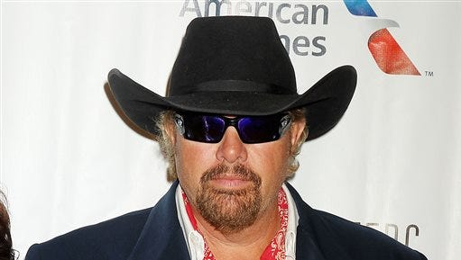In this image released by Starpix, country singer Toby Keith arrives at the Songwriters Hall of Fame 2015 46th Annual Induction and Awards Gala on Thursday, June 18, 2015, in New York.
