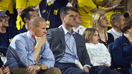 John Beilein, left, and Jim Harbaugh.