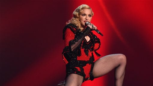 In this Feb. 8 file photo, Madonna performs at the 57th annual Grammy Awards in Los Angeles. From Madonna to Mariah Carey, more and more acts are looking to platforms like Tinder and Match to promote their music and reach their fans on-the-go. Madonna worked with Grindr, an app for gay men, to launch a campaign for her latest album, while Jason Derulo looked to Tinder to debut a music video.