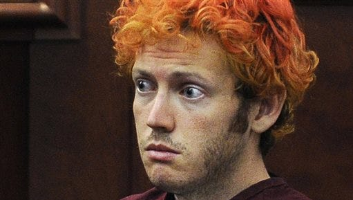 FILE - In this July 23, 2012, file photo, James Holmes, who is charged with killing 12 moviegoers and wounding 70 more in a shooting spree in a crowded theatre in 2012, sits in Arapahoe County District Court in Centennial, Colo. Prosecutors in the Colorado theater shooting trial will press a psychiatrist testifying for the defense that Holmes was psychotic and could not tell right from wrong when he killed 12 people at a packed movie premiere. District Attorney George Brauchler grilled Dr. Jonathan Woodcock on Thursday, June 25, 2015, to throw doubt on his conclusion that Holmes was seriously delusional around the July 20, 2012, attack.(RJ Sangosti/The Denver Post via AP, Pool, File)