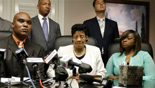 Attorney Cannon Lambert, left, along with Sandra Bland's mother Geneva Reed-Veal, center, and sister Sierra Cole hold a press conference Tuesday, Aug. 4, 2015, in Houston. Bland was found dead in a Texas county jail three days after a confrontation with a white state trooper. The family filed a wrongful-death lawsuit against the officer and other officials, saying it was a last resort after being unable to get enough information about the case. (AP Photo/Pat Sullivan)