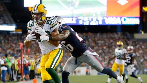 Green Bay Packers wide receiver Jeff Janis (83) catches a touchdown pass in front of New England Patriots cornerback Logan Ryan (26) during the first half of an NFL preseason football game Thursday, Aug. 13, 2015, in Foxborough, Mass. (AP Photo/Michael Dwyer)