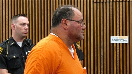 FILE-This Friday, July 17, 2015 file photo shows Carmine Agnello appearing in court in Cleveland. Agnello, a reputed member of New York's Gambino crime family has been indicted on charges that include racketeering, acts of pollution and other counts in what authorities says was a $4.2 million scam involving stolen cars and scrap metal. (Ida Lieszkovszky/The Plain Dealer via AP, File) MANDATORY CREDIT; NO SALES